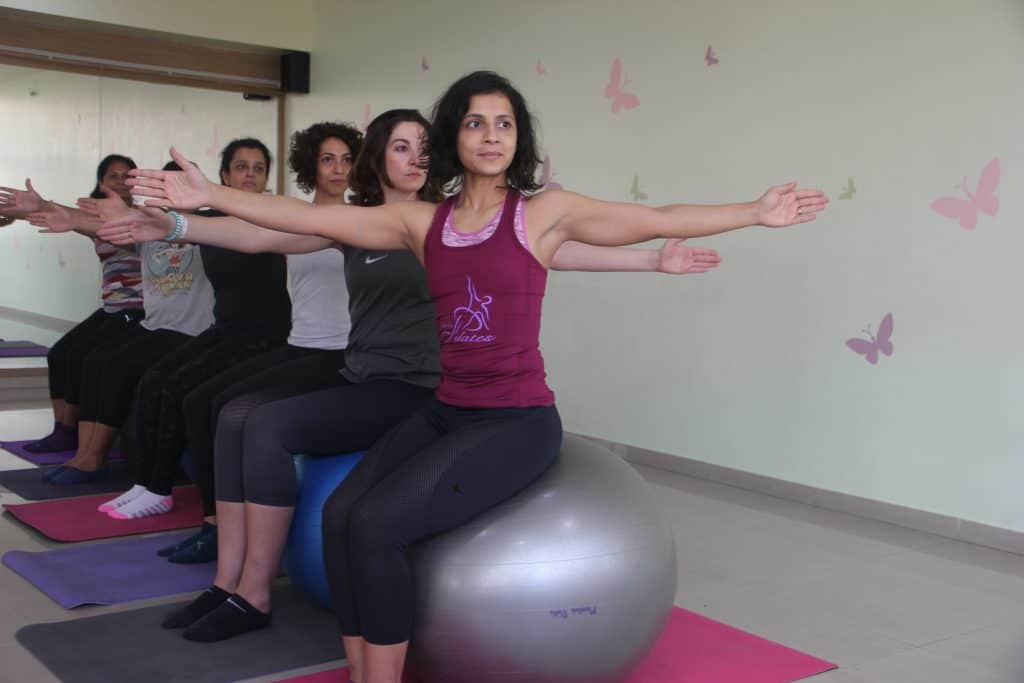 exercise ball in Pilates chosing size